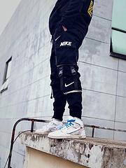 NIKE/耐克男女同款海外版高街织带机能风多口袋束脚宽松工装裤