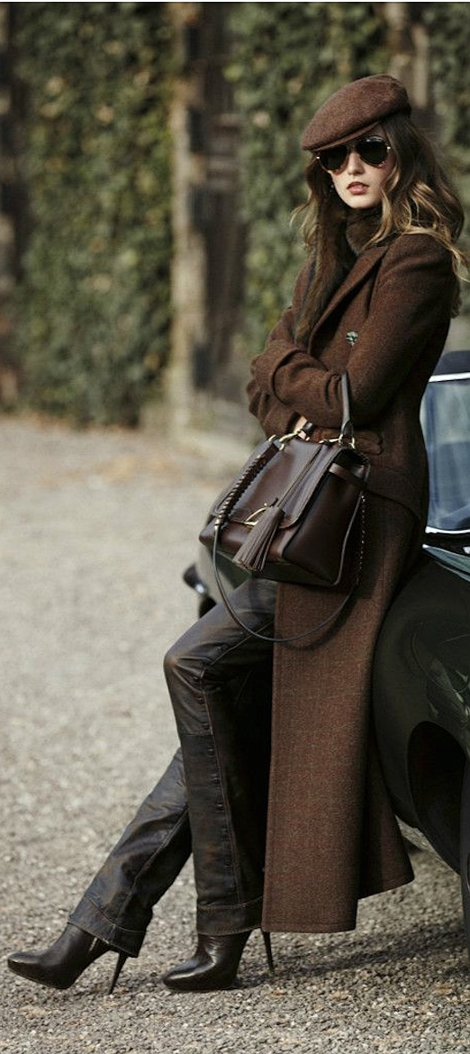 Black heels, black leather pants, a long brown maxi coat and topper. Shared by Brittany N Bros in Ontario.