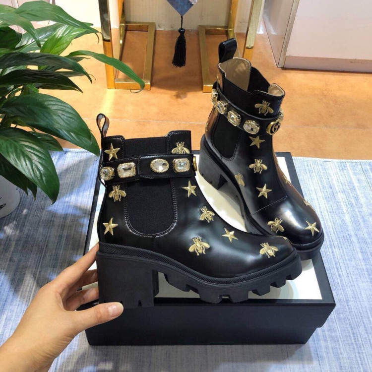 0fc8119b Women Embroidered leather ankle boot with belt ‎557735 AYO10 1000